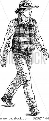 Vector drawing of a striding man in cowboy costume.