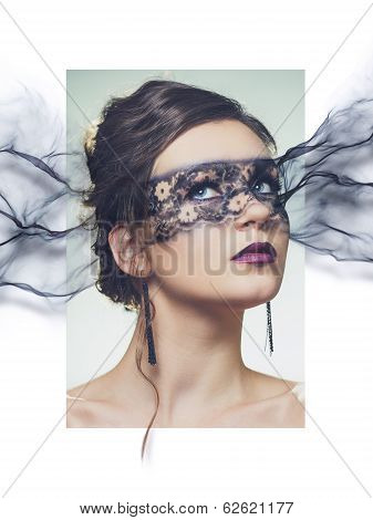 stylized portrait of young elegant woman with make-up mask