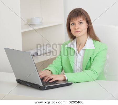 Young Beautiful Woman Works At Office With Computer