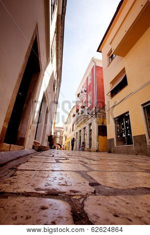 A small pretty street wtih cobblestone in Rab, Croatia