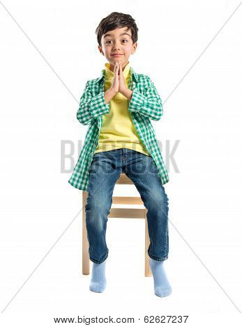 Blonde Boy Pleading Over Isolated White Background