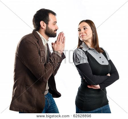 Men Pleading At His Girlfriend Over White Background