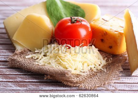 Different Italian cheese on wooden background