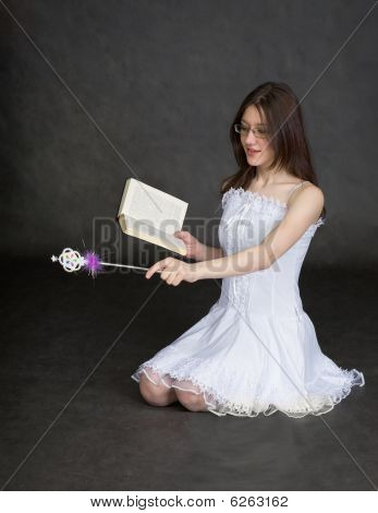 Girl - Fairy With Magic Wand And Book In Hands