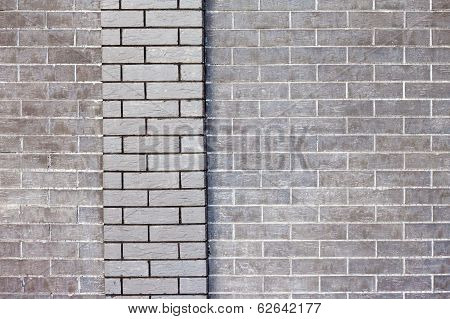 gray brick wall with a stripe