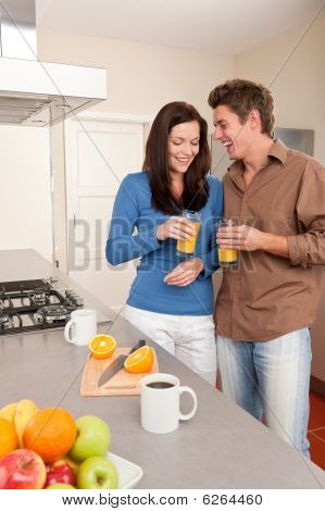Young Woman And Man In The Kitchen
