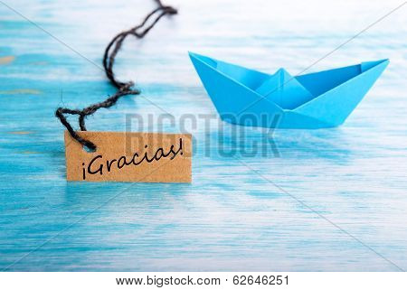 Label With Gracias And A Boat