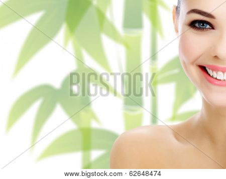 Pretty girl with green bamboo behind