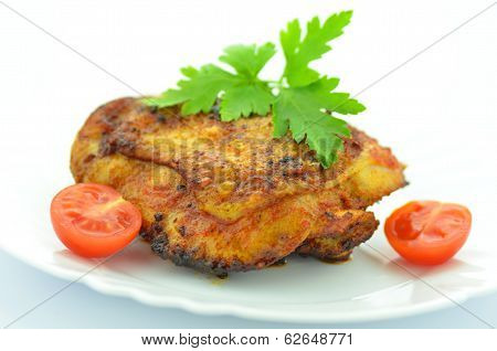 delicious fried chicken breast on white plate