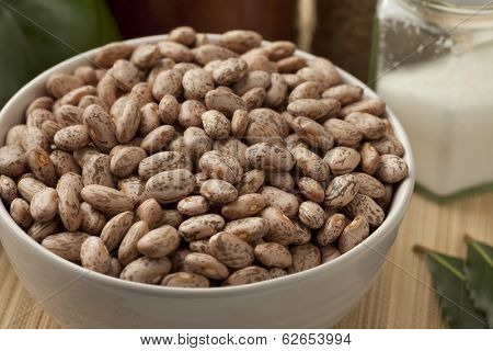 Bowl with pinto beans on the table