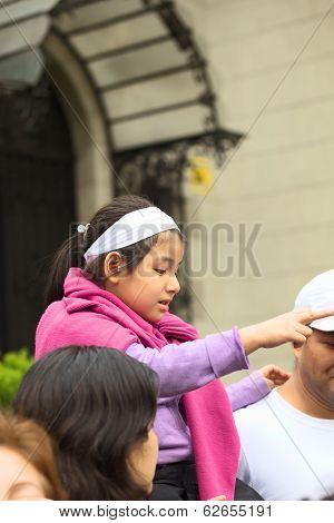Girl at Wong Parade in Lima, Peru