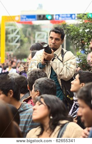 Man with Camera at the Wong Parade in Lima, Peru