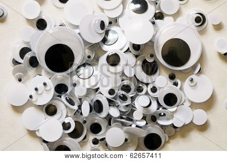 Googly eyes are small plastic craft supplies used to imitate eyeballs. Googly eyes traditionally are composed of a clear, hard-plastic shell, with a smaller, black plastic disk trapped within.