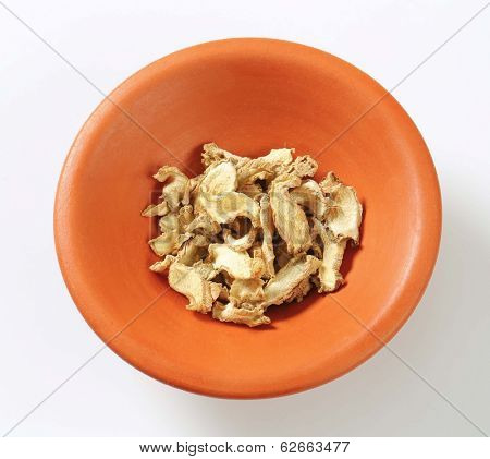 few slices of dried mushrooms, in the ceramic bowl