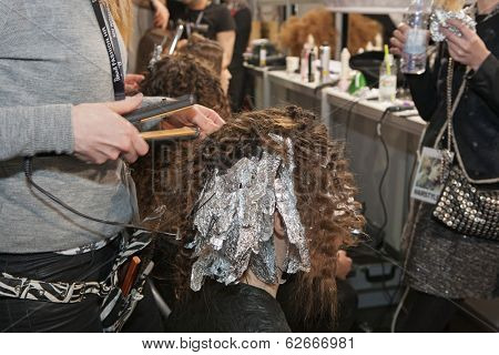 ZAGREB, CROATIA - MARCH 28, 2014: Fashion model in backstage preparing for a Couture show by Marina Design on 'Fashion.hr' fashion show