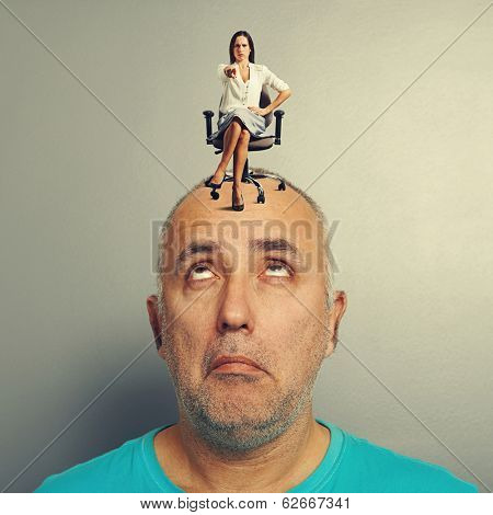 strict woman and amazed man over grey background