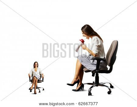 angry young woman and smiley calm woman on the chair over white background