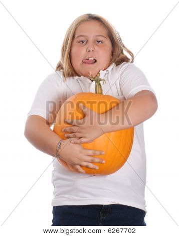 Girl Holding Large Pumpkin