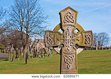 A Cross In Ancient Graveyard