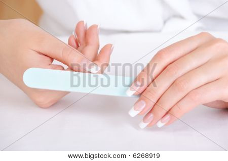 Female Polishing  Her Thumb