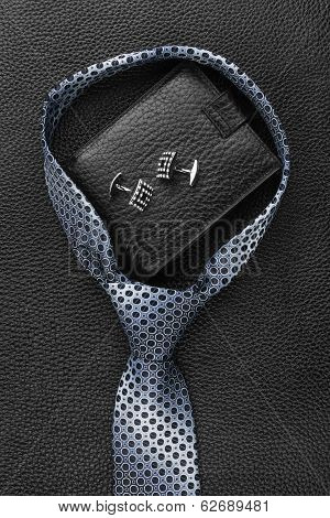 A Necktie, Wallet, Cufflinks  Lying On The Skin