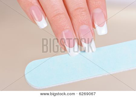 Woman Polishing Fingernails On Hand