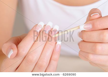 Female Hand  With  Stick For  Cleaning Cuticle