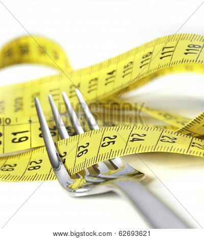 Silver Fork Wrapped In Measure Tape In Diet And Overweight Concept
