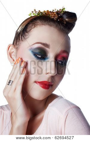 Closeup face of a woman with beautiful red lips and orange manicure - studio shot of bright fashion makeup