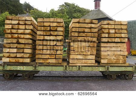 Planks Of Wood Stacked On Wagon.