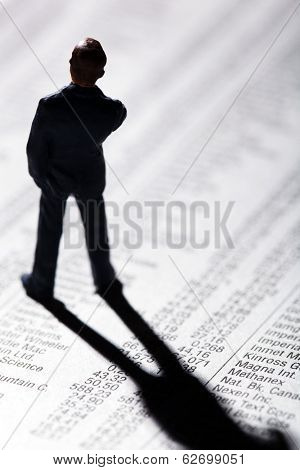 a small figure and the prices of shares in a newspaper. making money in the stock market. gains and losses in stock trading.