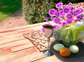 Jewish celebrate pesach passover with eggs, matzo and flowers on nature background