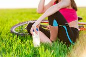Close up of attractive young active woman and bike