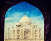 Vintage retro hipster style travel image of Taj Mahal through arch, Indian Symbol - India travel bac