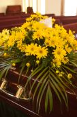 stock photo of coffin  - Flowers from the family on a casket at a funeral - JPG