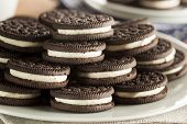 stock photo of fill  - Unhealthy Chocolate Cookies with Vanilla Cream Filling