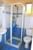 stock photo of shower-cubicle  - Shower cabinet in blue bathroom - JPG