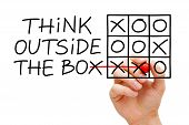 stock photo of tic-tac-toe  - Hand sketching Think Outside The Box tic - JPG