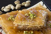 picture of baklava  - Close Up of Baklava on a Plate with Pistachio Nuts - JPG