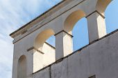 stock photo of mussolini  - an architectural detail featuring some archs on an old building - JPG