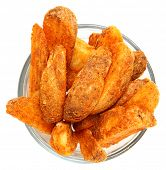 Spicy Potato Wedges in Glass Bowl Isolated Over White