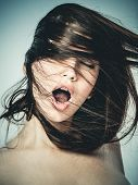 stock photo of human teeth  - Portrait of a young woman shouting in ecstasy - JPG
