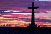 picture of camiguin  - Catholic cross silhouette in the sunken cemetery at dusk - JPG