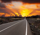 pic of canary-islands  - yellow sunset over asphalt road Canary island Lanzarote - JPG