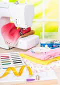 stock photo of sewing  - Sewing machine with colorful fabrics - JPG