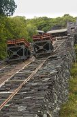 foto of gravity  - Restored gravity incline with trucks mounted on rails. Originally for taking slate from quarry.