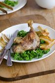 foto of roast duck  - Roast duck legs with steamed kale and roast parsnips - JPG