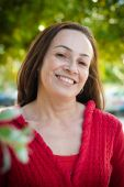 pic of casual woman  - Beautiful latin middle aged woman in the park smiling - JPG