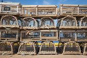 stock photo of lobster trap  - Stacks of wooden lobster traps on pier in North Rustico - JPG