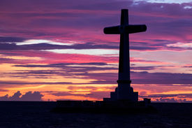 stock photo of camiguin  - Catholic cross silhouette in the sunken cemetery at dusk - JPG